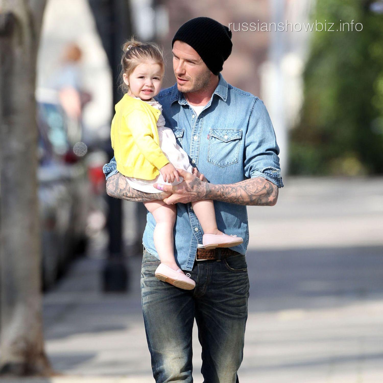 Дэвид Бекэм с дочкой